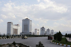 Wide boulevard with some new buildings1. A road with buildings near it. Ashkhabad. Turkmenistan Stock Photo