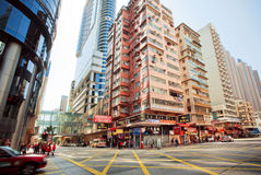 Wide broad street with skyscrapers and fast driving taxi car on city road of Hong Kong Stock Photography