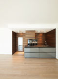Wide brown kitchen in modern apartment. Wide brown kitchen, electrical modern appliance Royalty Free Stock Photography