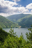 Wide calm river running through green forested hills in southern Bulgaria. On sunny summer day Stock Images