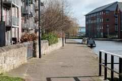 Wide Canal Towpath. The wide and paved towpath as it runs throught Wigan Stock Images