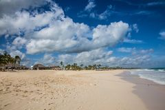 Wide caribbean beach at a cloudy day with ocean Royalty Free Stock Images