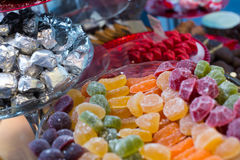 Wide choice of jelly sweets and colorful macaroons Royalty Free Stock Photography