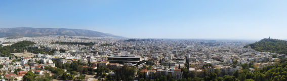 Wide city panorama from Acropolis of Athens. This panorama made from Acropolis of Athens offers a wide view over the ancient Greek city Stock Photos