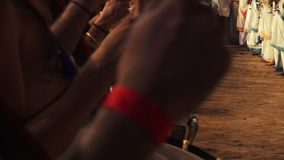 Musical artists entertain at Poonam ceremony. Wide Close up steady shot of culturally-dressed drum and flute players entertaining festival`s night attendants stock video footage