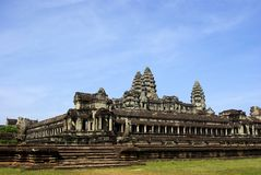 Wide corner view of Angkor Wat temple. It's a wide corner view of Angkor Wat temple with a blue sky royalty free stock images