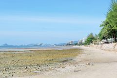 The wide corners of the morning beach with buildings in Thailand. Beachfront Attractions with beautiful sky royalty free stock photography
