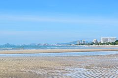 The wide corners of the morning beach with buildings in Thailand. Beachfront Attractions with beautiful sky.n stock image