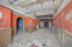 A wide corridor with a collapsed suspended ceiling stock photo