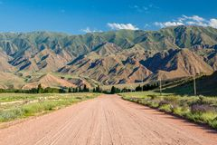 Wide country road in Kyrgyzstan Stock Image