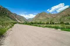 Wide country road in mountains Stock Image