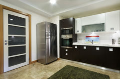 Wide Domestical Kitchen with Door. Wide Domestical Kitchen view with Door and refrigerator Royalty Free Stock Photo
