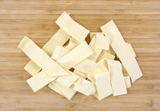 Wide egg noodles on cutting board Stock Image
