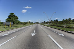 Wide empty road in cuba habana. Wide angle empty road with road sign arrows in cuba, habana Stock Image