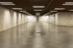 Wide empty underpass. Empty underpass with lights and grey tiled Royalty Free Stock Image