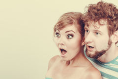 Wide eyed couple surprised expression open mouth. Emotional facial expression wide eyed couple, women an men looking surprised open mouth Royalty Free Stock Photos