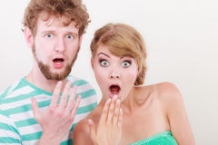 Wide eyed couple surprised expression open mouth Stock Photos