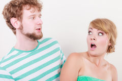 Wide eyed couple surprised expression open mouth. Emotional facial expression wide eyed couple, women an men looking surprised to each other girl open mouth royalty free stock image
