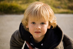 Wide Eyed Little Boy. Outdoor portrait of a wide eyed little boy Stock Photo