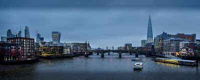 Wide eyed in London with a shard in the eye royalty free stock images