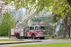 Wide on Fireman Testing Truck Equipment. Firemen test equipment on their fire truck in Vancouver on May 10, 2017 Stock Image
