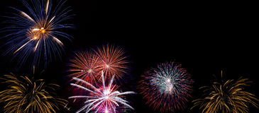 Wide Fireworks DIsplay made of real pyrotechnic photos. Very large firework background with 100 percent pure black Royalty Free Stock Photography