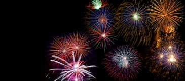 Wide Fireworks DIsplay made of real pyrotechnic photos. Very large firework background with 100 percent pure black Royalty Free Stock Image