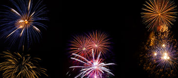 Wide Fireworks DIsplay made of real pyrotechnic photos. Very large firework background with 100 percent pure black Royalty Free Stock Photo