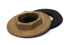 Wide Flange Nut And Gaskets. A photo taken on two gaskets and a brass basin and kitchen tap wide flange nut against a white backdrop Royalty Free Stock Photography
