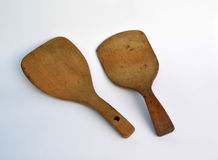 Wide flat antique wooden butter paddles Royalty Free Stock Photo