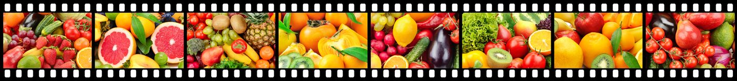 Wide frame in form of film strip with fruits and vegetables. royalty free stock photography