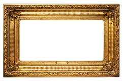 Wide Golden Picture Frame w/ Path. Antique golden picture frame with artistic ornamentation and a small blank textbox. File contains a clipping path royalty free stock photography