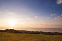 Wide Grass field by the ocean in Ishigaki island, Okinawa, Japan. Wide Grass field by the ocean at sunset or sunrise in Ishigaki island, Okinawa, Japan Royalty Free Stock Photos