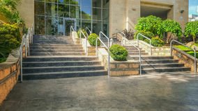 Wide hand railing stairway to multi-story condominium Stock Photos