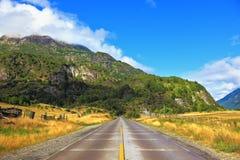 Wide highway runs between fields Stock Images