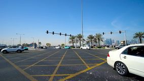 Wide intersection, Doha, Qatar. DOHA, QATAR - FEBRUARY 13, 2018: The traffic on wide  intersection of Banks and Corniche streets with a view on the coast and stock video