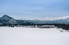 Wide landscape of small village and mountain range in Fukushima, Stock Photography