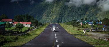 Wide Landscape View of Aircraft Landing on Tenzing–Hillary Air. Port Runway, Lukla Nepal royalty free stock photography