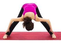 Wide Legged Forward Bend Variation in Yoga royalty free stock images