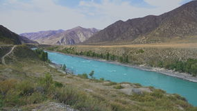 Wide Mointain River With Blue Water Slowly Flowing With The Mountain Range Beautiful LAndscape View. Wide Mountain River With Blue Water Slowly Flowing With The stock video