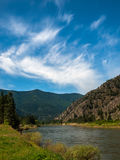 Wide Mountain River Cuts a Valley Stock Photography