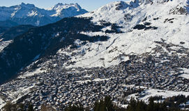 Wide mountain village. View of verbier in the swiss alps on perfect crisp winters day, perspective compression from extreme telephoto lens Stock Photography
