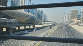A wide multi-lane road in Dubai. View from the subway crossing. A wide multi-lane road in Dubai. View from the subway crossing stock video