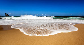 Wide ocean wave with foam Stock Photos