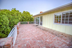 Wide open deck in ranch style home in California with brick floor. Outdoors in Southern California homes ready for real estate listings Royalty Free Stock Photography