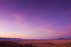 Wide Open Desert Sunrise. Wide open desert landscape with sage brush and mountains at sunrise Stock Images