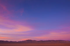 Wide Open Desert Sunset. Wide open desert landscape with sage brush and mountains at sunset Royalty Free Stock Photography