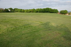 Wide open field in a city Stock Photo