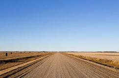 Wide open gravel road Stock Images