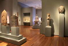 Wide-open room with ancient statues on heavy pedestals,Cleveland Art Museum,Ohio,2016 Stock Photo